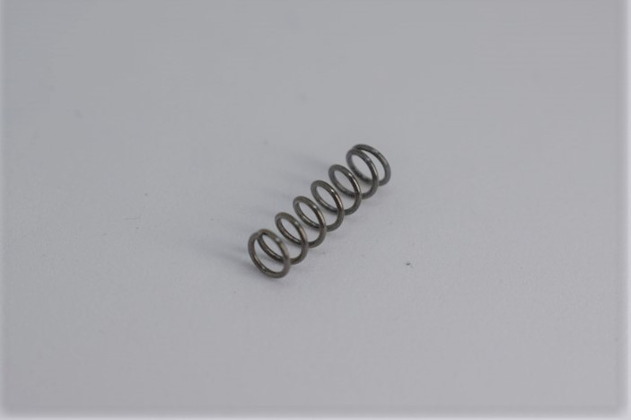 Duplex coiled spring for release screw